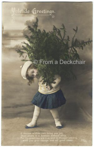 Vintage Christmas postcard of a little girl carrying a Christmas tree